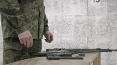 Soldier assembles rifle Part 1 / 2 Stock Footage