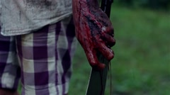Monster holding a knife dripping blood Stock Footage