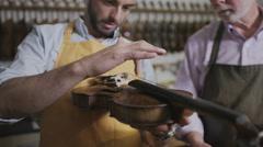 4K Craftsmen in their workshop, making and restoring violins Stock Footage