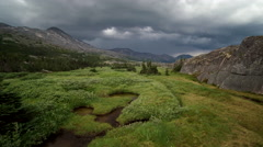 Stormy Weather over Windy Alpine Meadow Lakes Forward Aerial Stock Footage