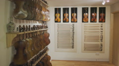 4K Racks of stringed instruments on display in a musical store. No people Stock Footage