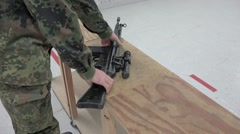 Soldier assembles rifle Part 3 / 3 Stock Footage