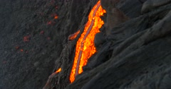 Hawaiian Lava flowing from Kilauea volcano Hawaii Stock Footage