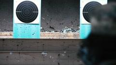 Soldier firing rifle – Detail of target Stock Footage
