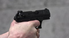 Soldier firing Walther P99 – Detail shot Stock Footage