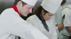4K Team of chefs preparing food in a commercial kitchen Stock Footage