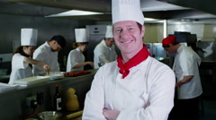 4K Portrait of smiling head chef and his staff in a commercial kitchen Arkistovideo