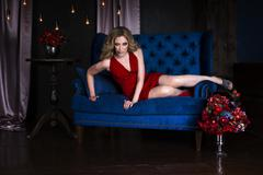 Beautiful young blonde woman in red dress with halloween make up and Kuvituskuvat