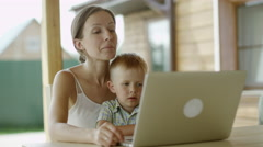 Mother and son video chatting Stock Footage