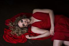 Beautiful young blonde woman in red dress with halloween make up and Stock Photos
