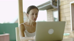 Woman video conferencing on laptop Stock Footage