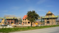 Time lapse traffic passing construction of new houses united kingdom Stock Footage