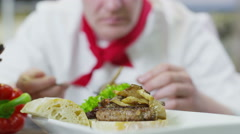 4K Delicious gourmet burger is being given the finishing touches by the chef Stock Footage