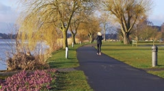 Running girl near the lake Stock Footage