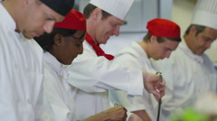 4K Happy team of chefs preparing and cooking food in a commercial kitchen Stock Footage