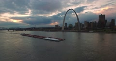 Beautiful aerial over a Mississippi river barge with the St. Louis, Missouri Stock Footage
