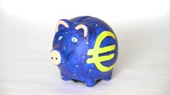 Coins Move Down In A Piggy Bank Stock Footage