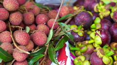 Pile of delicious tropical fruit, Lychee and Mangosteen Stock Footage