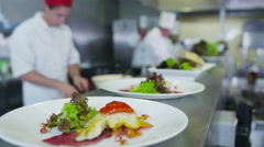 4K Professional chefs in restaurant or hotel kitchen looking at digital tablet Stock Footage