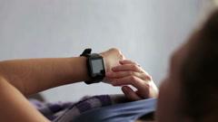 Woman Lying in Bed Woken Up by Alarm Clock App on Smart Watch Stock Footage