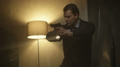 4K Police detectives with handguns & flashlights investigating gloomy apartment. Stock Footage