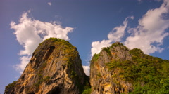 Summer sunny day krabi beach rock tops blue sky 4k time lapse thailand Stock Footage