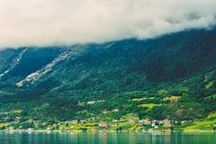 Scandinavian Village On Shore Of Hardangerfjord In Norway Stock Photos
