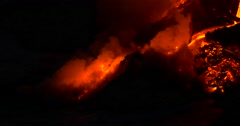 Close up Lava flowing from Kilauea volcano Hawaii at night Stock Footage