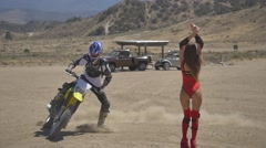 Lifestream Extreme cyclist rides around a girl in a red bathing suit Stock Footage