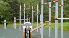 Man doing workout on the playground. Stock Footage