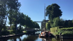 Canal with a bridge and sailboat in Blokzijl Stock Footage