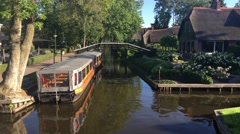 Boats in a canal in Giethoorn Stock Footage
