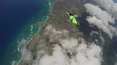 Lifestream men jumping with a wingsuit parachute over Hawaii, slow motion Stock Footage