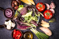 Assortment of fresh vegetables close up on black table Stock Photos