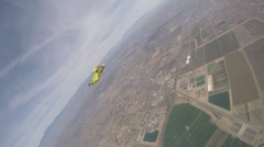 Lifestream men jumping with a wingsuit parachute, slow motion Stock Footage