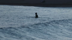 Man in sea with waves Stock Footage
