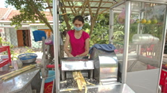Woman Makes Sugar-cane Juice with Machine in Street Stock Footage
