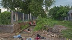 Children Bathe in Rice Field Canal in Village in Vietnam Stock Footage