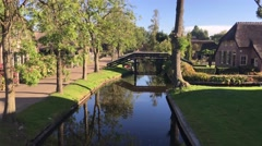 Bridge over a canal in Giethoorn Stock Footage