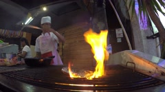 Thai Chef Grilling Food on Barbeque Flame in Restaurant. 4K. Stock Footage