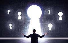 Businessman looking through keyhole Stock Photos