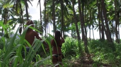 Man and pregnant woman is running through the jungle Hawaii, slow motion Stock Footage