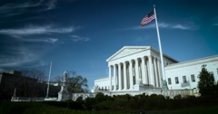 The US Supreme Court wide 4K blue sky high clouds nice flags Stock Footage
