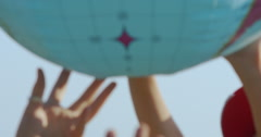 Various Hands Playing With Plastic Earth Globe Stock Footage