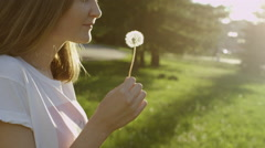 Woman with dandelion clock Stock Footage