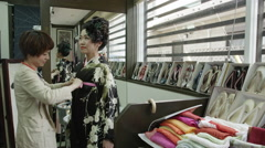 Dressing up in a Ceremonial Kimono Stock Footage