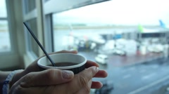 Female Passenger at Airport with Hot Tea. Waiting hall. Flight Delay Stock Footage