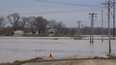 Flooding washes out a road during intense storms in Missouri in 2016. Stock Footage