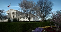 The US Supreme Court Wide full building slow motion with flowers blooming Stock Footage
