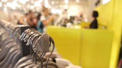 Buyers or Customers Shopping for Clothes in Clothing Shop Stock Footage
